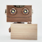 robot wooden holds ad