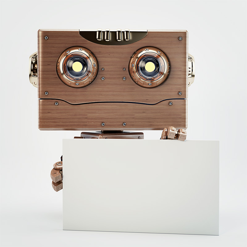 wooden robot holds blank board