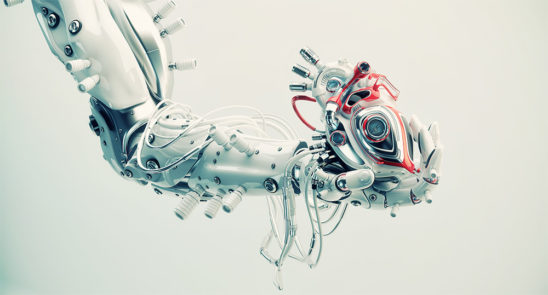 Stylish robot arm holds artificial futuristic heart