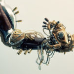 Wooden robot arm holds heart