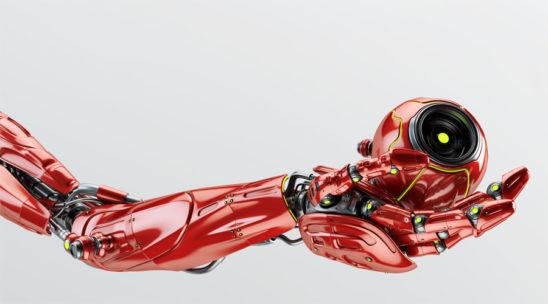 Robotic arm holding remote camera drone