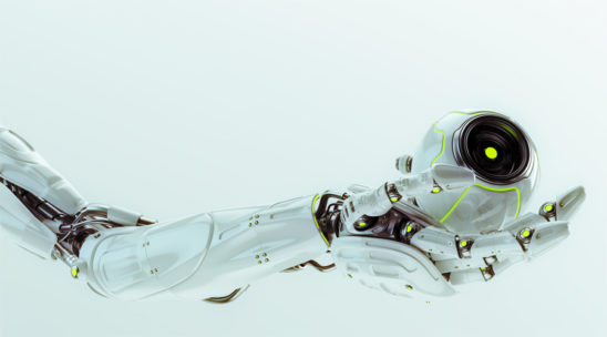 White robotic arm holding remote camera drone