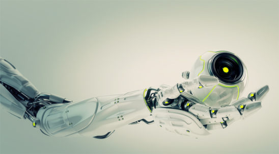 White robotic arm holding remote camera drone