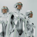 Three futuristic robot women in VR. Silver sexy cyborgs trio